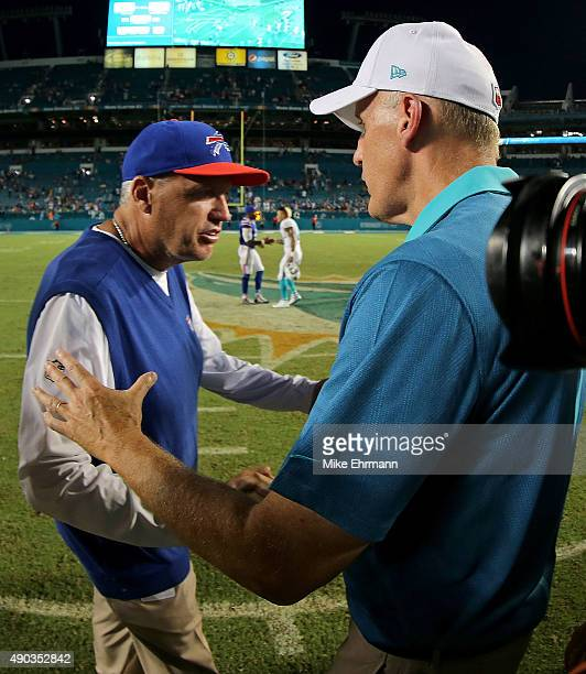 Head coach Rex Ryan of the Buffalo Bills shakes hands with head coach Joe Philbin of the Miami Dolphins during a game at Sun Life Stadium on...