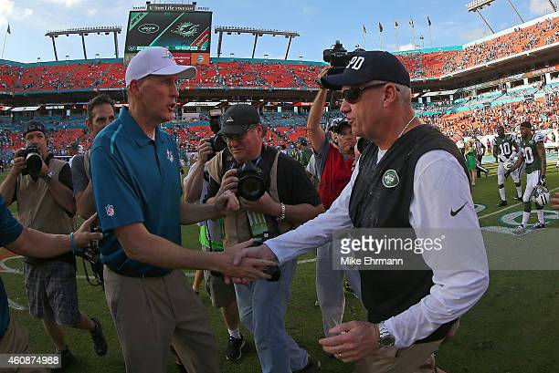 Head coach Rex Ryan of the New York Jets and head coach Joe Philbin of the Miami Dolphins shake hands following a game at Sun Life Stadium on...