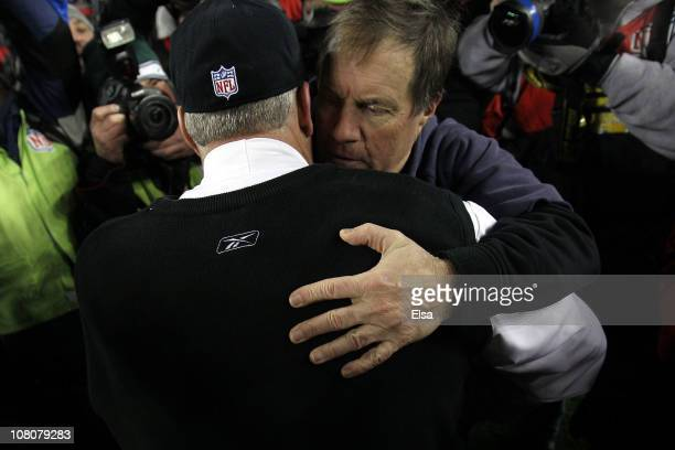 Head coach Rex Ryan of the New York Jets hugs head coach Bill Belichick of the New England Patriots after the Jets defeated the Patriots 28 to 21...