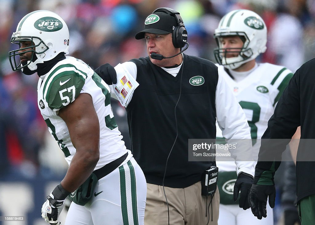 Head coach Rex Ryan of the New York Jets sends Bart Scott #57 into the game during an NFL game against the Buffalo Bills at Ralph Wilson Stadium on December 30, 2012 in Orchard Park, New York.