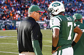 Head coach Rex Ryan of the New York Jets speaks to Geno Smith after a game against the Denver Broncos at MetLife Stadium on October 12 2014 in East...