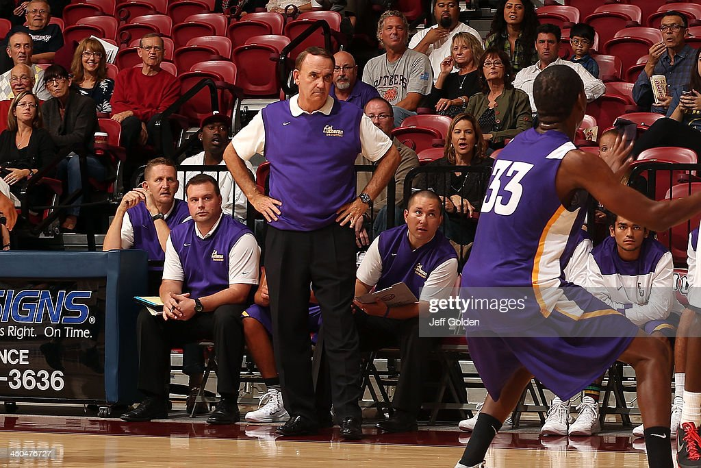 Head coach Rich Rider of the Cal Lutheran Kingsmen looks on from in front of the bench against the Loyola Marymount Lions, along with assistant coaches (l-r) Bob Massell, Geoff Dains and Brendan Garrett during the exhibition game at Gersten Pavilion on November 2, 2013 in Los Angeles, California. Loyola Marymount won 96-64.