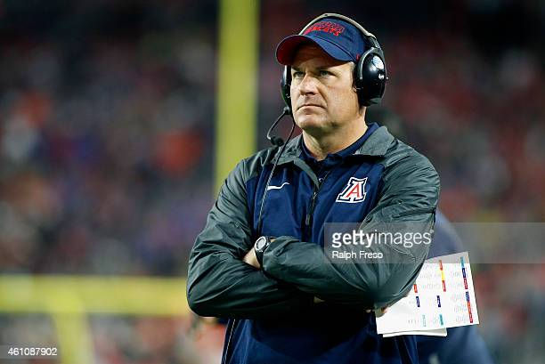 Head coach Rich Rodriguez of the Arizona Wildcats looks on from the sideline during second quarter action against the Boise State Broncos in the...