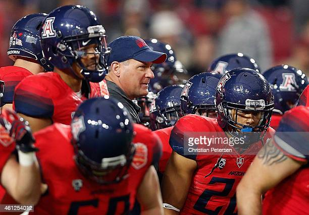 Head coach Rich Rodriguez of the Arizona Wildcats watches warm ups before the Vizio Fiesta Bowl against the Boise State Broncos at University of...