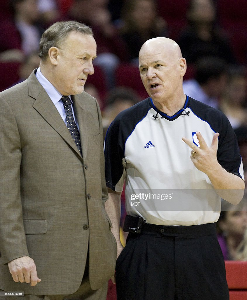 Head coach Rick Adelman of the Houston Rockets, left, talks with referee Joey Crawford as his team faces the Denver Nuggets in the first half of their game on Monday, February 14, 2011, in Houston, Texas.