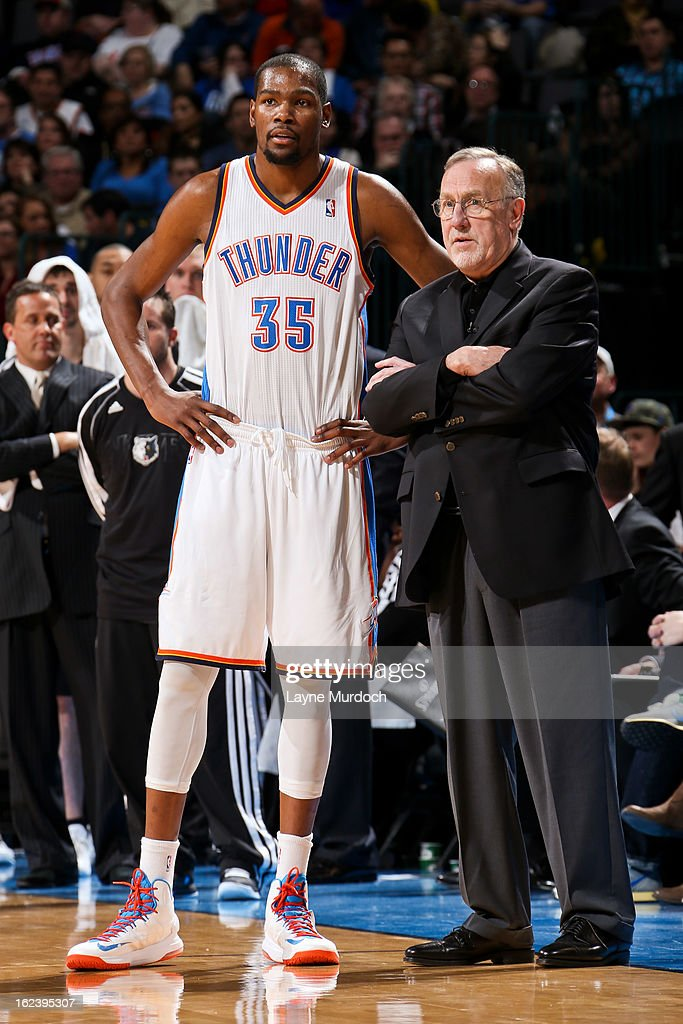 Head Coach Rick Adelman of the Minnesota Timberwolves speaks with Kevin Durant #35 of the Oklahoma City Thunder during a game between the two teams on February 22, 2013 at the Chesapeake Energy Arena in Oklahoma City, Oklahoma.