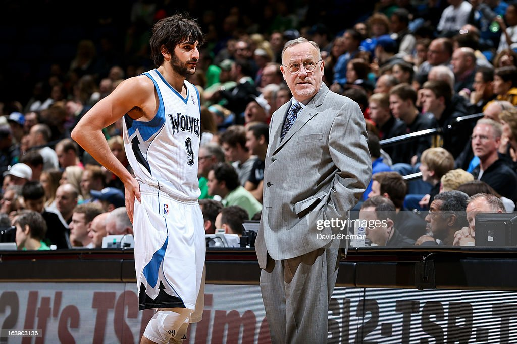 Head Coach Rick Adelman of the Minnesota Timberwolves speaks with Ricky Rubio #9 during a game against the New Orleans Hornets on March 17, 2013 at Target Center in Minneapolis, Minnesota.