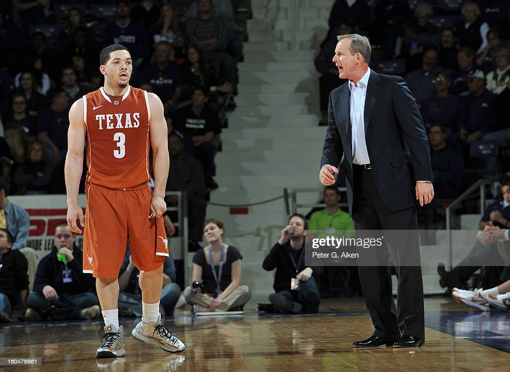 Head coach Rick Barnes (R) of the Texas Longhorns calls out to guard Javan Felix #3 during the second half against the Kansas State Wildcats on January 30, 2013 at Bramlage Coliseum in Manhattan, Kansas.