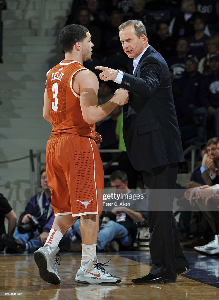 Head coach Rick Barnes of the Texas Longhorns talks with guard Javan Felix #3 during the first half against the Kansas State Wildcats on January 30, 2013 at Bramlage Coliseum in Manhattan, Kansas. Kansas State defeated Texas 83-57.