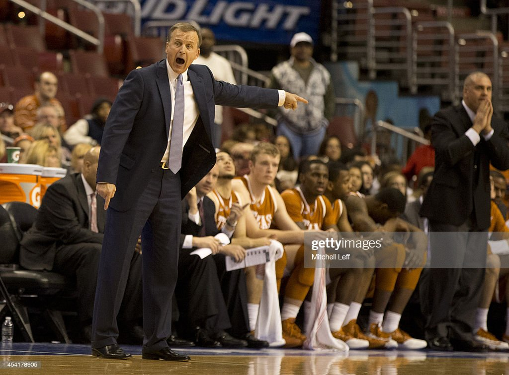 Head coach <a gi-track='captionPersonalityLinkClicked' href=/galleries/search?phrase=Rick+Barnes&family=editorial&specificpeople=728815 ng-click='$event.stopPropagation()'>Rick Barnes</a> of the University of Texas Longhorns reacts during the game against the Temple University Owls on December 7, 2013 at the Wells Fargo Center in Philadelphia, Pennsylvania.