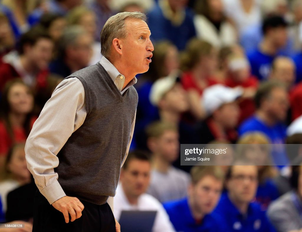 Head coach Rick Byrd of the Belmont Bruins coaches from the bench during the game against the Kansas Jayhawks at Allen Fieldhouse on December 15, 2012 in Lawrence, Kansas.