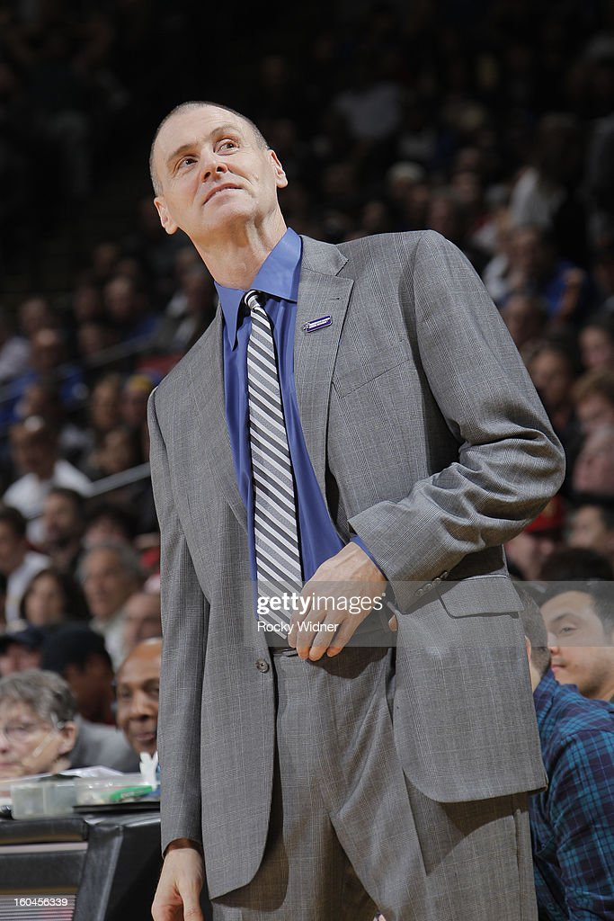 Head coach Rick Carlisle of the Dallas Mavericks checks the scoreboard during a game against the Golden State Warriors on January 31, 2013 at Oracle Arena in Oakland, California.