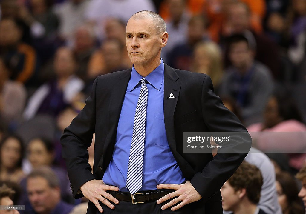 Head coach <a gi-track='captionPersonalityLinkClicked' href=/galleries/search?phrase=Rick+Carlisle&family=editorial&specificpeople=206971 ng-click='$event.stopPropagation()'>Rick Carlisle</a> of the Dallas Mavericks reacts during the NBA game against the Phoenix Suns at US Airways Center on December 21, 2013 in Phoenix, Arizona. The Suns defeated the Mavericks 123-108.