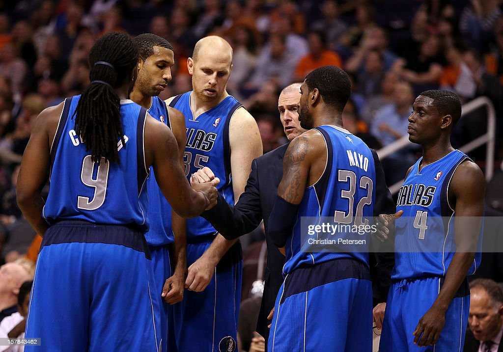 Head coach <a gi-track='captionPersonalityLinkClicked' href=/galleries/search?phrase=Rick+Carlisle&family=editorial&specificpeople=206971 ng-click='$event.stopPropagation()'>Rick Carlisle</a> of the Dallas Mavericks talks with his team in a huddle during the NBA game against the Phoenix Suns at US Airways Center on December 6, 2012 in Phoenix, Arizona. The Mavericks defeated the Suns 97-94.