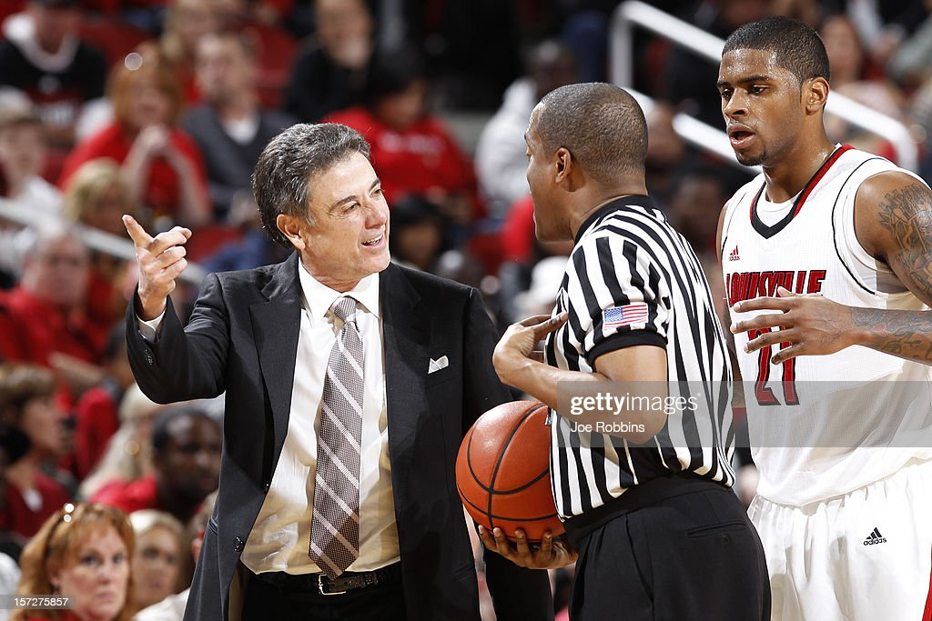Head coach <a gi-track='captionPersonalityLinkClicked' href=/galleries/search?phrase=Rick+Pitino&family=editorial&specificpeople=210871 ng-click='$event.stopPropagation()'>Rick Pitino</a> and Chane Behanan #21 of the Louisville Cardinals question an official during the game against the Illinois State Redbirds at KFC Yum! Center on December 1, 2012 in Louisville, Kentucky. Louisville won 69-66.