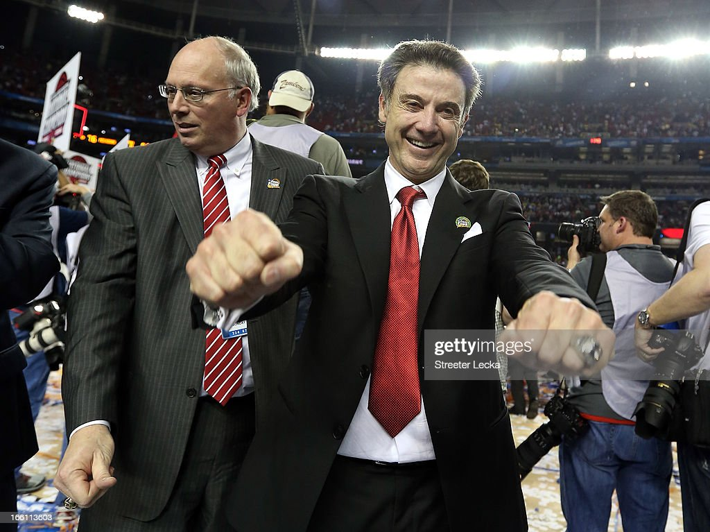 Head coach Rick Pitino (R) and Sports and Information Director Kenny Klein of the Louisville Cardinals celebrate after they won 82-76 against the Michigan Wolverines during the 2013 NCAA Men's Final Four Championship at the Georgia Dome on April 8, 2013 in Atlanta, Georgia.