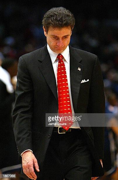Head coach Rick Pitino of Louisville walks off the court after being defeated 7971 by Butler in the second round of the NCAA Tournament on March 23...