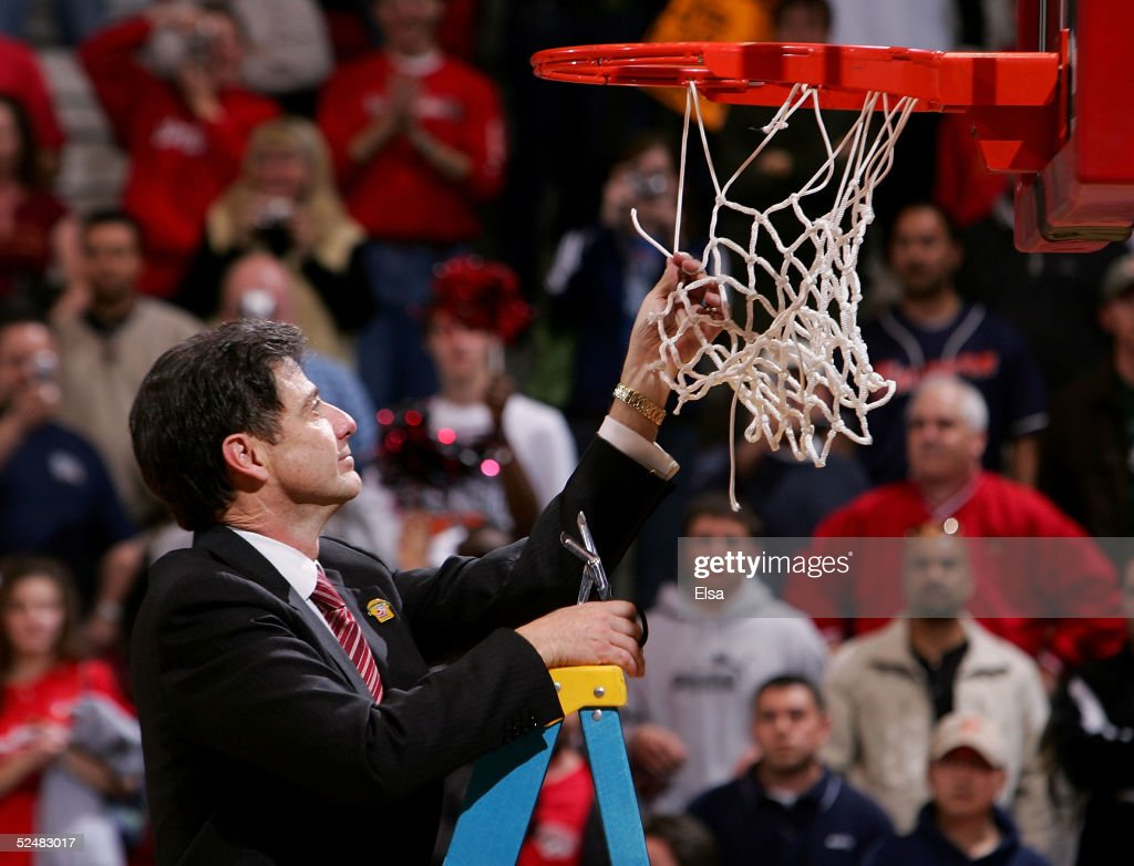 Head coach Rick Pitino of the cuts down the net after the Cardinals' victory over the West Virginia Mountaineers in overtime during the Elite 8 game of the NCAA Division I Men's Basketball Tournament on March 26, 2005 at The Pit in Albuquerque, New Mexico. The Cardinals won in overtime 93-85 and will advance to the Final Four. Pitino becomes the first coach to take three different teams to the Final Four.