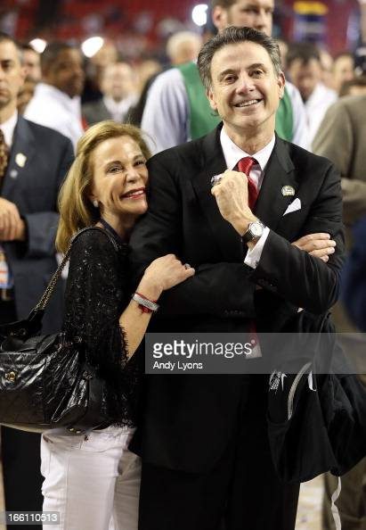 Head coach Rick Pitino of the Louisville Cardinals and his wife Joanne celebrate after they won 8276 against the Michigan Wolverines during the 2013...