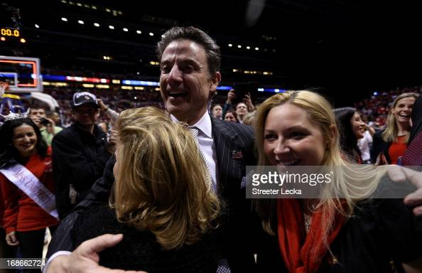 head coach Rick Pitino of the Louisville Cardinals celebrates with his wife Joanne after the Louisville Cardinals won against the Duke Blue Devils...