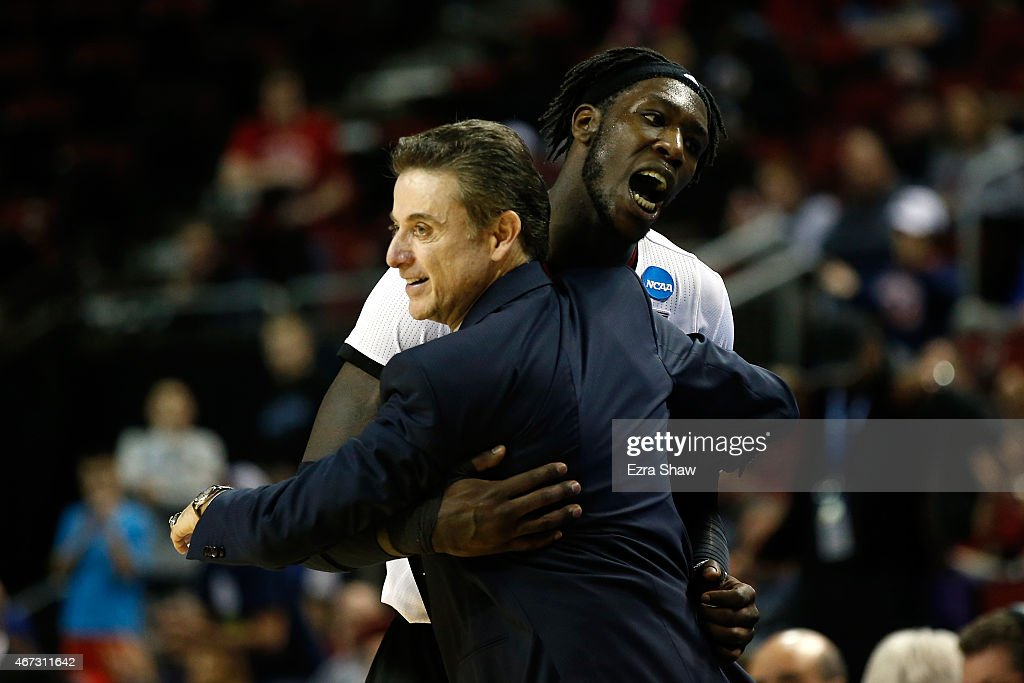 Head coach Rick Pitino of the Louisville Cardinals celebrates with Montrezl Harrell #24 after defeating the Northern Iowa Panthers 66 to 53 during the third round of the 2015 NCAA Men's Basketball Tournament at KeyArena on March 22, 2015 in Seattle, Washington.