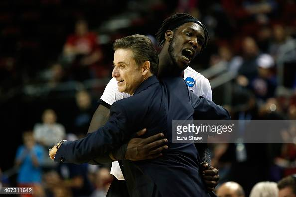 Head coach Rick Pitino of the Louisville Cardinals celebrates with Montrezl Harrell after defeating the Northern Iowa Panthers 66 to 53 during the...