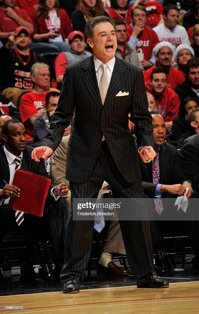 Head coach <a gi-track='captionPersonalityLinkClicked' href=/galleries/search?phrase=Rick+Pitino&family=editorial&specificpeople=210871 ng-click='$event.stopPropagation()'>Rick Pitino</a> of the Louisville Cardinals coaches his team against of the Western Kentucky Hilltoppers at Bridgestone Arena on December 22, 2012 in Nashville, Tennessee.