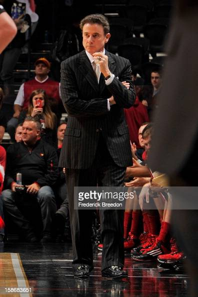 Head coach Rick Pitino of the Louisville Cardinals coaches his team against the Western Kentucky Hilltoppers at Bridgestone Arena on December 22 2012...