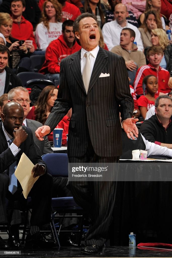 Head coach <a gi-track='captionPersonalityLinkClicked' href=/galleries/search?phrase=Rick+Pitino&family=editorial&specificpeople=210871 ng-click='$event.stopPropagation()'>Rick Pitino</a> of the Louisville Cardinals coaches his team against the Western Kentucky Hilltoppers at Bridgestone Arena on December 22, 2012 in Nashville, Tennessee.