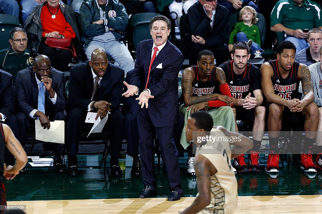 Head coach <a gi-track='captionPersonalityLinkClicked' href=/galleries/search?phrase=Rick+Pitino&family=editorial&specificpeople=210871 ng-click='$event.stopPropagation()'>Rick Pitino</a> of the Louisville Cardinals directs his team against the South Florida Bulls during the game at the Sun Dome on February 17, 2013 in Tampa, Florida.