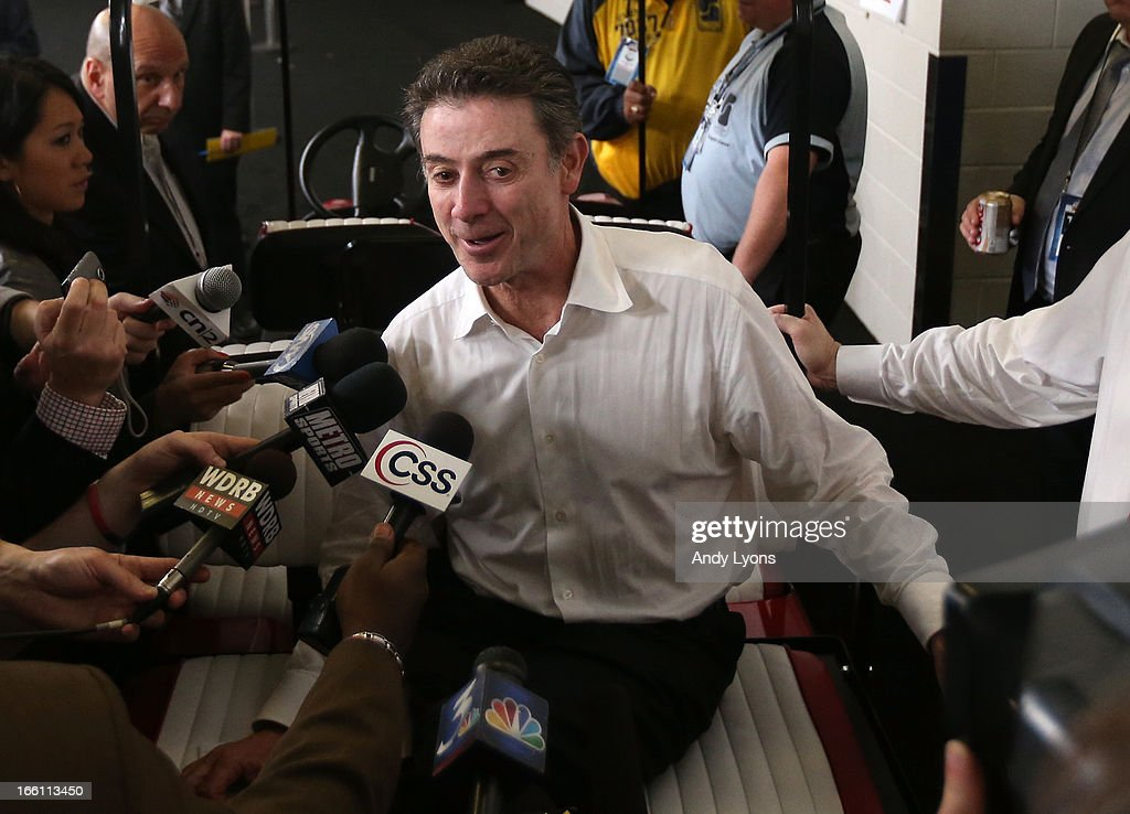 Head coach Rick Pitino of the Louisville Cardinals is interviewed by the media outside the locker room after they won 82-76 against the Michigan Wolverines during the 2013 NCAA Men's Final Four Championship at the Georgia Dome on April 8, 2013 in Atlanta, Georgia.