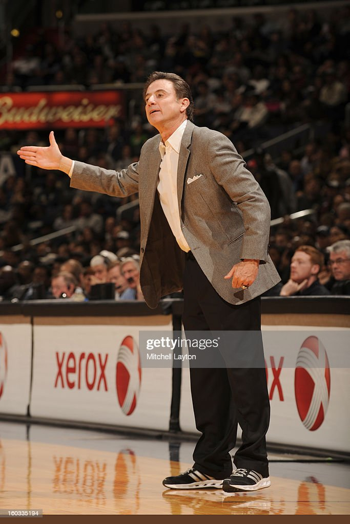 Head coach <a gi-track='captionPersonalityLinkClicked' href=/galleries/search?phrase=Rick+Pitino&family=editorial&specificpeople=210871 ng-click='$event.stopPropagation()'>Rick Pitino</a> of the Louisville Cardinals looks on during a college basketball game against the Georgetown Hoyas on January 26, 2013 at Verizon Center in Washington, DC. The Hoyas won 53-51.