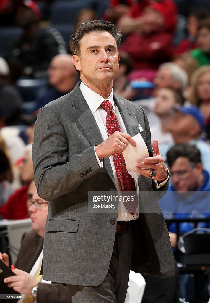 Head coach <a gi-track='captionPersonalityLinkClicked' href=/galleries/search?phrase=Rick+Pitino&family=editorial&specificpeople=210871 ng-click='$event.stopPropagation()'>Rick Pitino</a> of the Louisville Cardinals looks on from the bench against the Houston Cougars during the semifinals of the American Athletic Conference Tournament at FedExForum on March 14, 2014 in Memphis, Tennessee. Louisville defeated Houston 94-65.