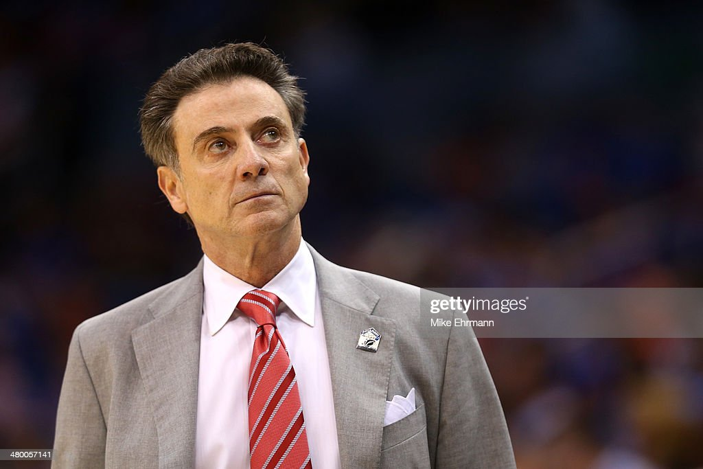 Head coach <a gi-track='captionPersonalityLinkClicked' href=/galleries/search?phrase=Rick+Pitino&family=editorial&specificpeople=210871 ng-click='$event.stopPropagation()'>Rick Pitino</a> of the Louisville Cardinals looks on in the first half while taking on the Saint Louis Billikens during the third round of the 2014 NCAA Men's Basketball Tournament at Amway Center on March 22, 2014 in Orlando, Florida.