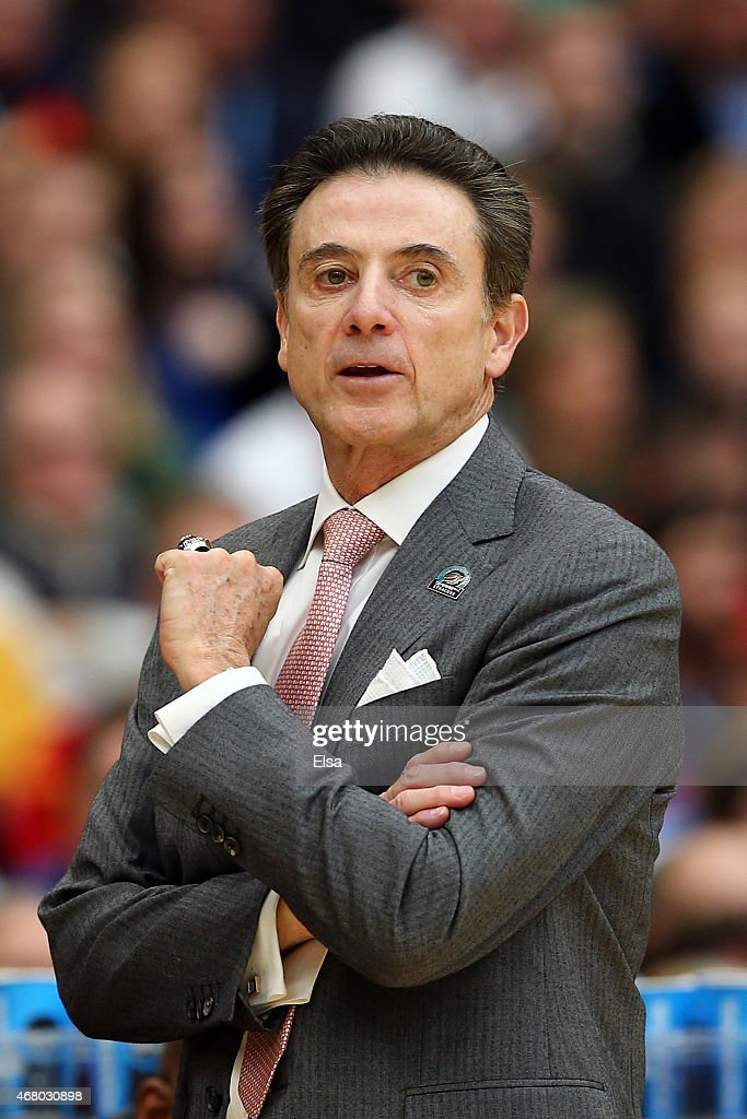 Head coach <a gi-track='captionPersonalityLinkClicked' href=/galleries/search?phrase=Rick+Pitino&family=editorial&specificpeople=210871 ng-click='$event.stopPropagation()'>Rick Pitino</a> of the Louisville Cardinals looks on the first half of the game against the Michigan State Spartans during the East Regional Final of the 2015 NCAA Men's Basketball Tournament at Carrier Dome on March 29, 2015 in Syracuse, New York.