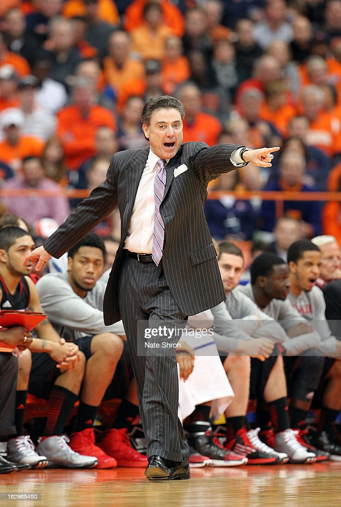 Head coach <a gi-track='captionPersonalityLinkClicked' href=/galleries/search?phrase=Rick+Pitino&family=editorial&specificpeople=210871 ng-click='$event.stopPropagation()'>Rick Pitino</a> of the Louisville Cardinals points from the sideline during the game against the Syracuse Orange at the Carrier Dome on March 2, 2013 in Syracuse, New York.