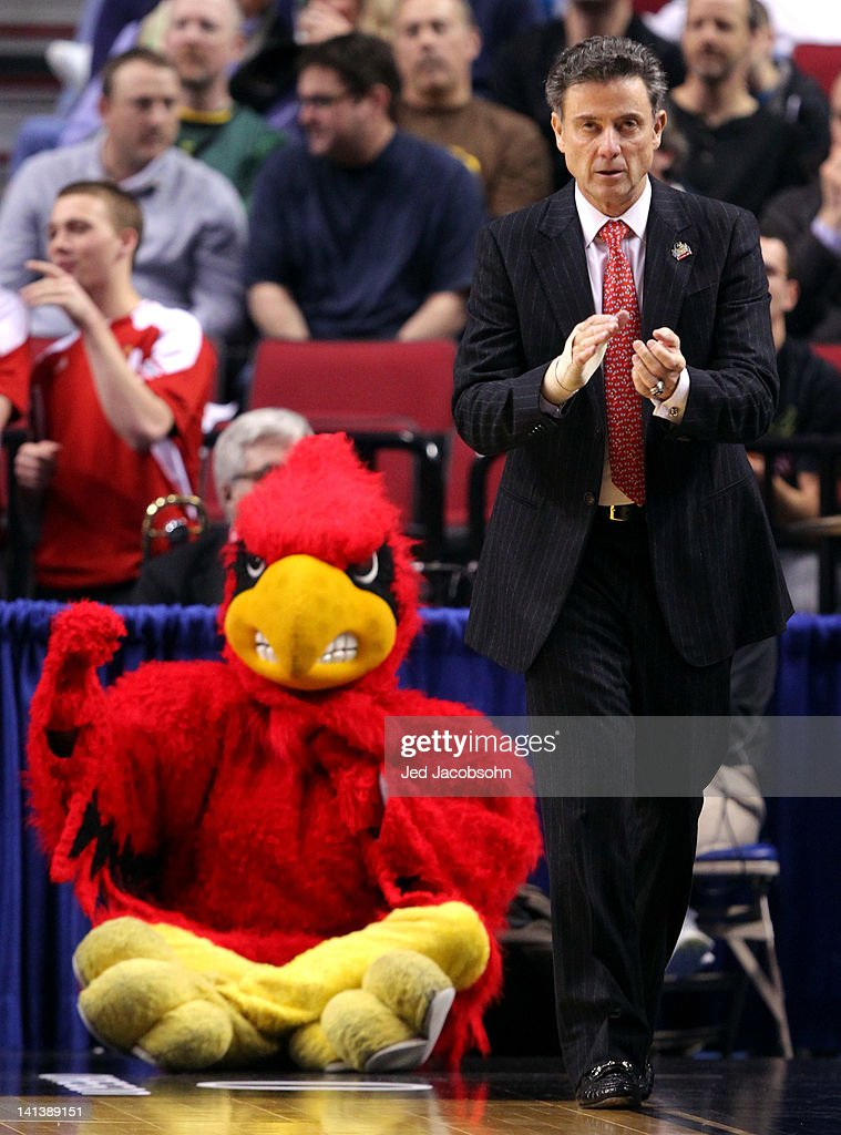 Head coach <a gi-track='captionPersonalityLinkClicked' href=/galleries/search?phrase=Rick+Pitino&family=editorial&specificpeople=210871 ng-click='$event.stopPropagation()'>Rick Pitino</a> of the Louisville Cardinals reacts as well as the Louisville Cardinals mascot in the second half against the Davidson Wildcats in the second round of the 2012 NCAA men's basketball tournament at Rose Garden Arena on March 15, 2012 in Portland, Oregon.