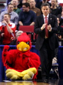 Head coach Rick Pitino of the Louisville Cardinals reacts as well as the Louisville Cardinals mascot in the second half against the Davidson Wildcats...