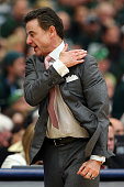 Head coach Rick Pitino of the Louisville Cardinals reacts in the first half of the game against the Michigan State Spartans during the East Regional...