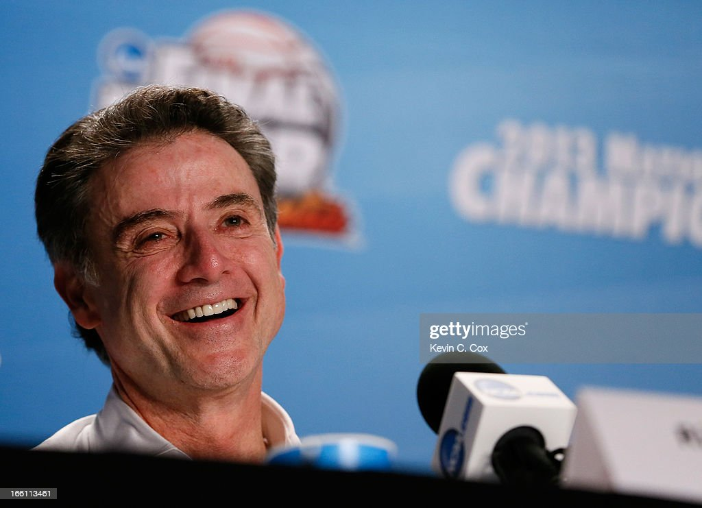 Head coach Rick Pitino of the Louisville Cardinals smiles as he answers questions from the media at his post game press conference after they won 82-76 against the Michigan Wolverines during the 2013 NCAA Men's Final Four Championship at the Georgia Dome on April 8, 2013 in Atlanta, Georgia.