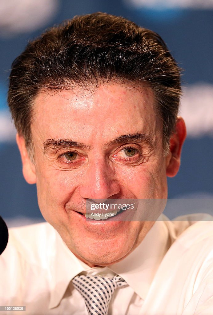 Head coach Rick Pitino of the Louisville Cardinals smiles as speaks at his post game press conference after they won 85-63 against the Duke Blue Devils during the Midwest Regional Final round of the 2013 NCAA Men's Basketball Tournament at Lucas Oil Stadium on March 31, 2013 in Indianapolis, Indiana.