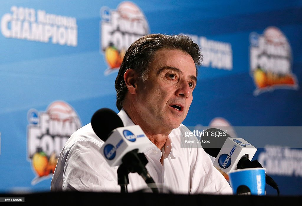 Head coach Rick Pitino of the Louisville Cardinals speaks with the media at his post game press conference after they won 82-76 against the Michigan Wolverines during the 2013 NCAA Men's Final Four Championship at the Georgia Dome on April 8, 2013 in Atlanta, Georgia.