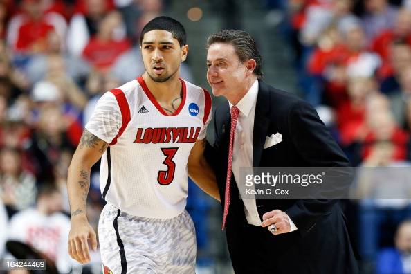 Head coach Rick Pitino of the Louisville Cardinals talks with Peyton Siva against the North Carolina AT Aggies during the second round of the 2013...