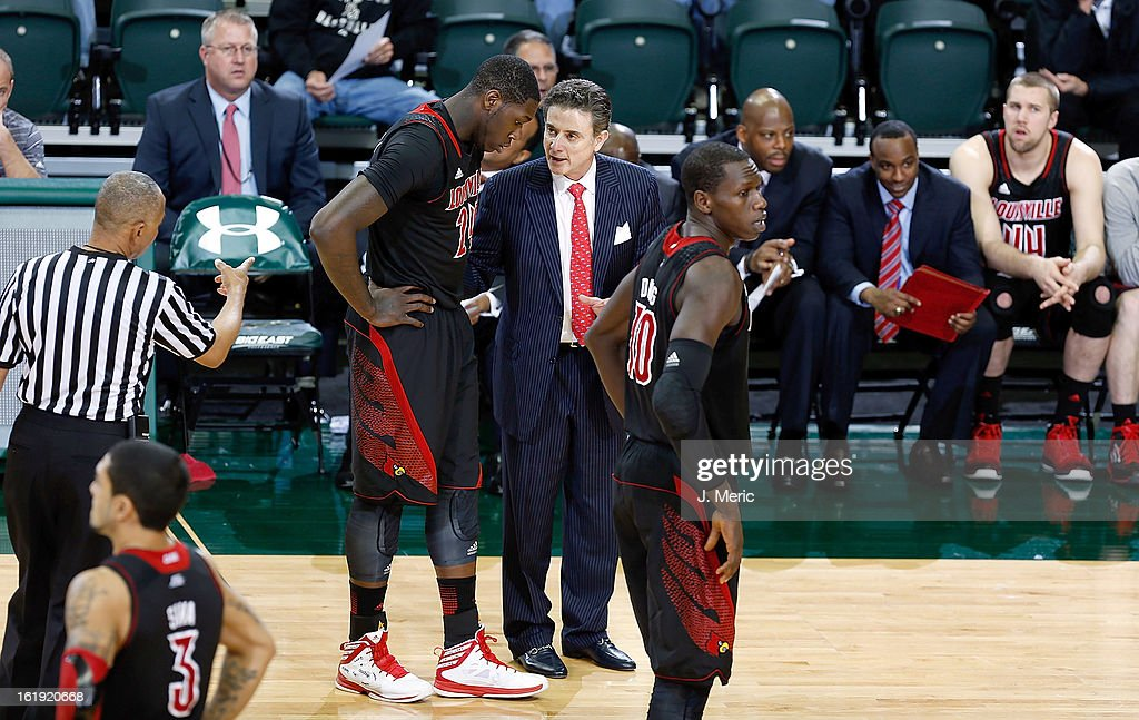 Head coach Rick Pitino of the Louisville Cardinals talks with Montrezl Harrell #24 during the game against the South Florida Bulls at the Sun Dome on February 17, 2013 in Tampa, Florida.