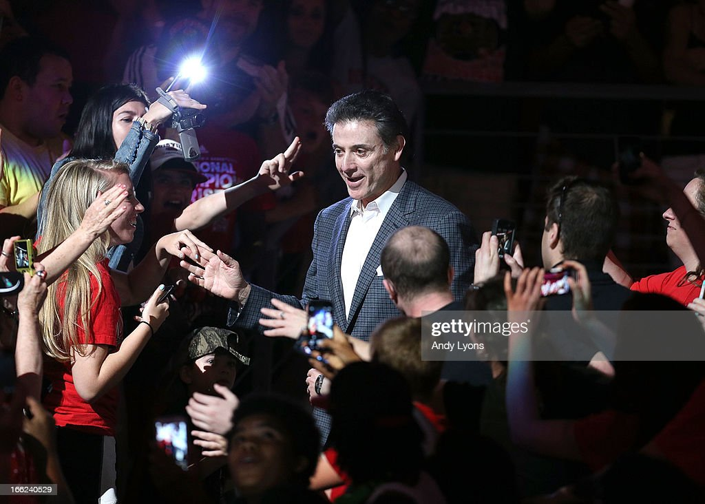 Head coach Rick Pitino of the Louisville Cardinals walks thru the crowd during the Louisville Cardinals NCAA Basketball Celebration to mark the NCAA championship by the Mens team and the runner-up finish by the womens team at KFC YUM! Center on April 10, 2013 in Louisville, Kentucky.