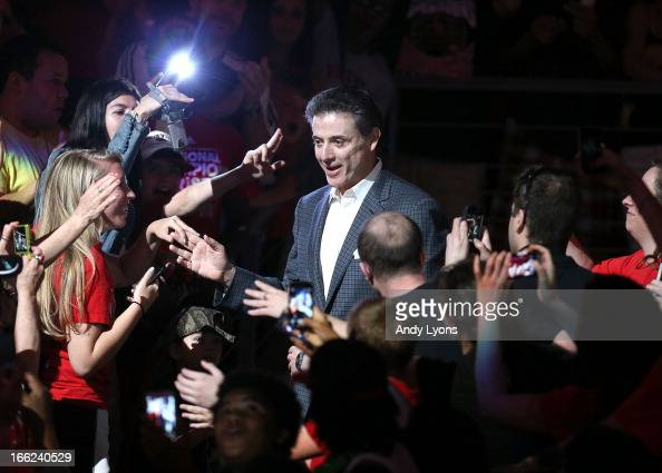 Head coach Rick Pitino of the Louisville Cardinals walks thru the crowd during the Louisville Cardinals NCAA Basketball Celebration to mark the NCAA...