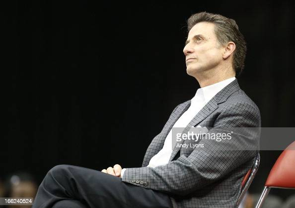 Head coach Rick Pitino of the Louisville Cardinals watches a video presentation during the Louisville Cardinals NCAA Basketball Celebration to mark...