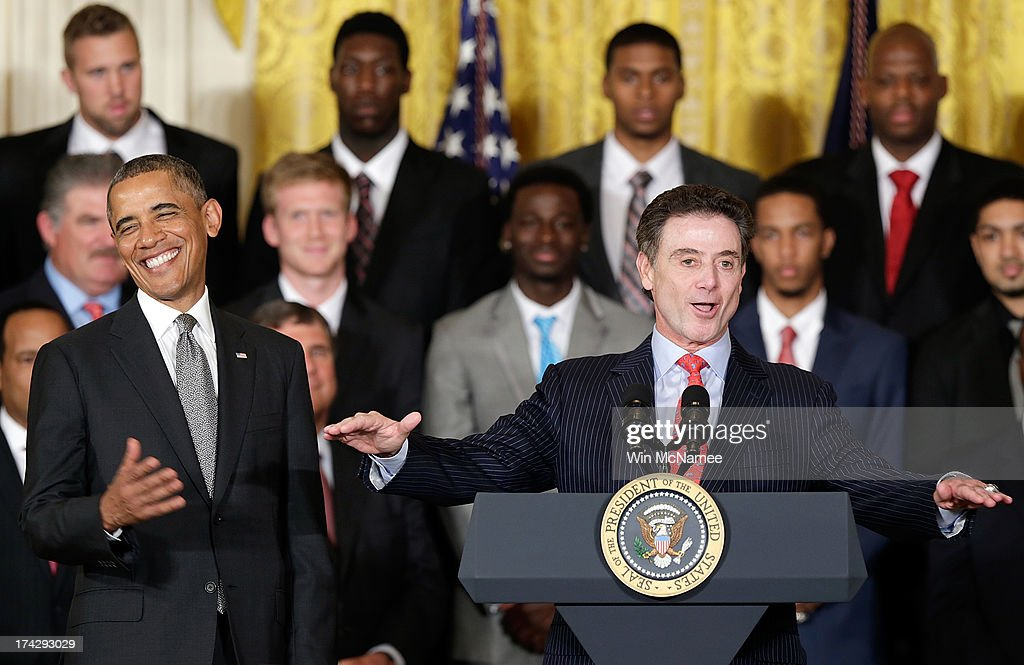 Head coach <a gi-track='captionPersonalityLinkClicked' href=/galleries/search?phrase=Rick+Pitino&family=editorial&specificpeople=210871 ng-click='$event.stopPropagation()'>Rick Pitino</a> (R) speaks with U.S. President <a gi-track='captionPersonalityLinkClicked' href=/galleries/search?phrase=Barack+Obama&family=editorial&specificpeople=203260 ng-click='$event.stopPropagation()'>Barack Obama</a> during an event honoring the Louisville Cardinals, the 2013 NCAA Men's Basketball Champions, in the East Room of the White House July 23, 2013 in Washington, DC. The Louisville Cardinals defeated the Michigan Wolverines in the championship game by a score of 82-76.