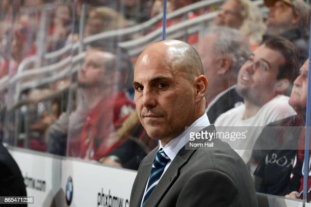 Head coach Rick Tocchet of the Arizona Coyotes looks on from the bench during a game against the Chicago Blackhawks at Gila River Arena on October 21...