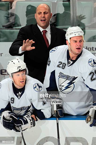 Head Coach Rick Tocchet of the Tampa Bay Lightning directs his team from the bench against the Florida Panthers at the BankAtlantic Center on April...